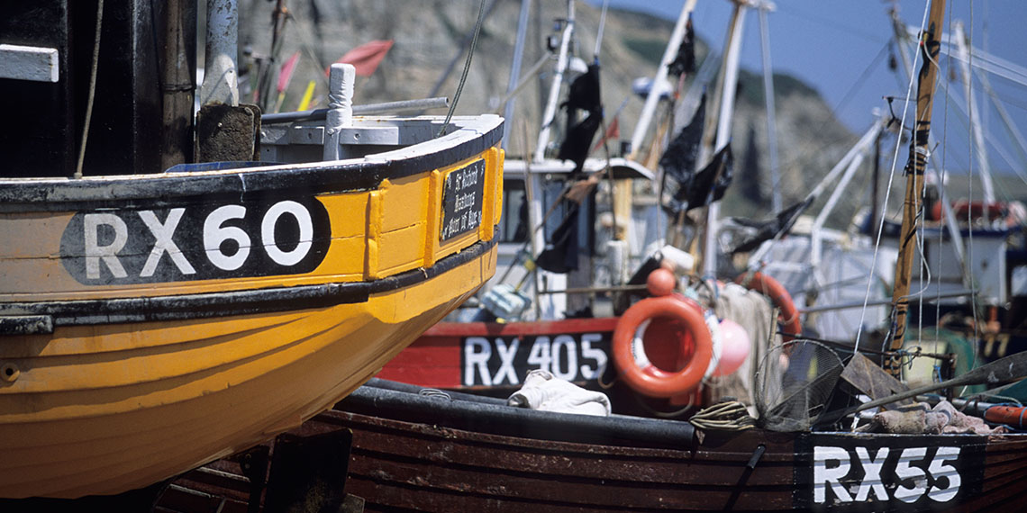 Fishing boats at a fishery on the English Channel Hastings UK